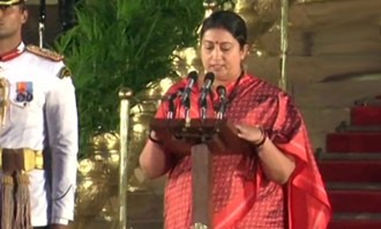 Smriti Irani sworn in as cabinet minister, కేంద్రమంత్రిగా ప్రమాణం చేసిన స్మృతి ఇరానీ