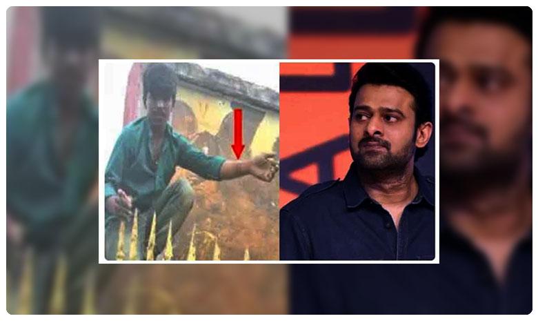 Saaho : Prabhas die hard fan cuts his arm to apply blood on saaho poster