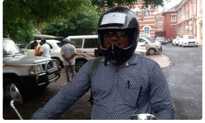 Vadodara Man Pastes All Bike Documents On Helmet To Beat Motor Vehicles Act: No Fine Now
