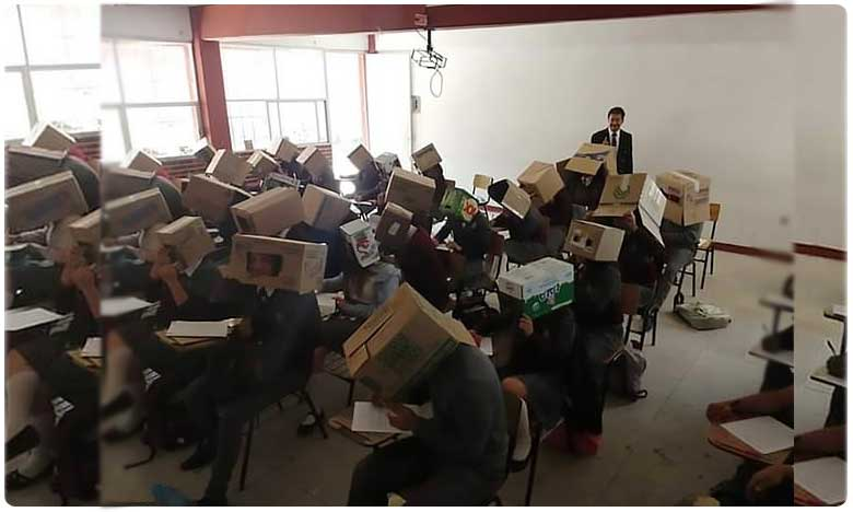 mexican teacher stops students cheating during exams by putting cardboard boxes on their heads