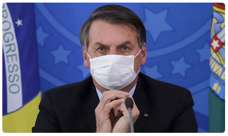 Brazil President Bolsonaro takes off mask after announcing he has tested Corona positive, బ్రెజిల్లో కరోనా విలయ తాండవం.. అధ్యక్షుడికి పాజిటివ్..