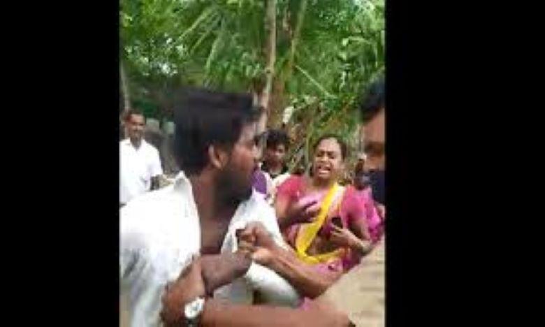 woman slapping violent cop goes viral in tamilnadu, భర్తను కొట్టిన పోలీసు చెంప పగులగొట్టిన భార్య