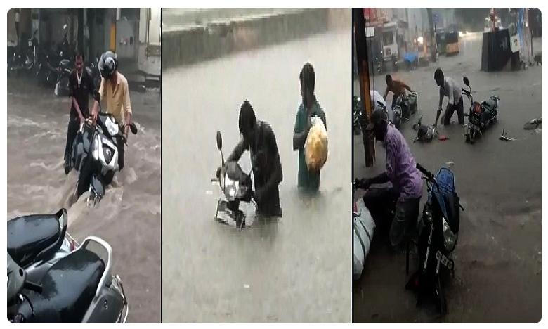 Heavy rains in Hyderabad, వర్షం నీటిలో భాగ్యనగరం.. రోడ్లపై మోకాల్లోతు నీళ్లు