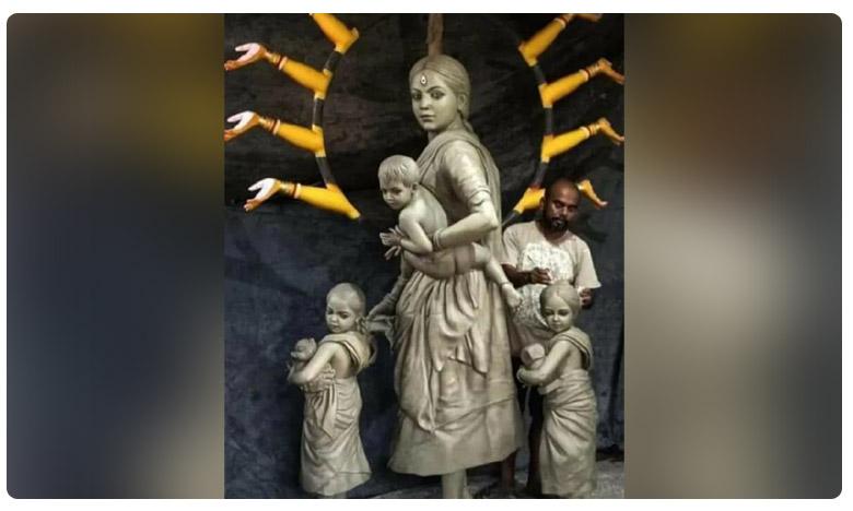 Migrant Worker Statue, దసరా ఉత్సవాలు: బిడ్డలను ఎత్తుకున్న 'దుర్గమ్మ'.. మొత్తానికి ఇంటికి చేరుకుంది